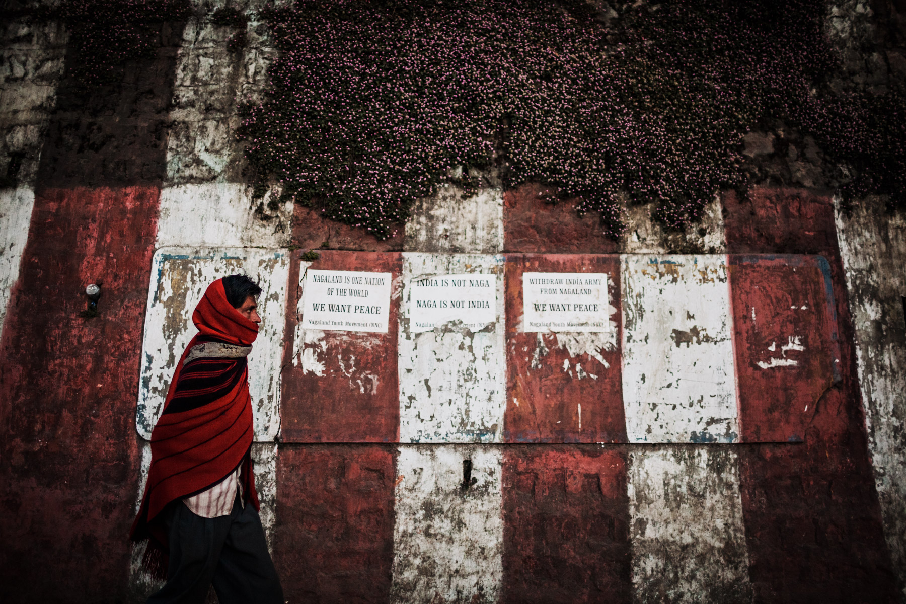 A man walks past signs calling for the annexation and freedom of Nagaland in northeastern India.