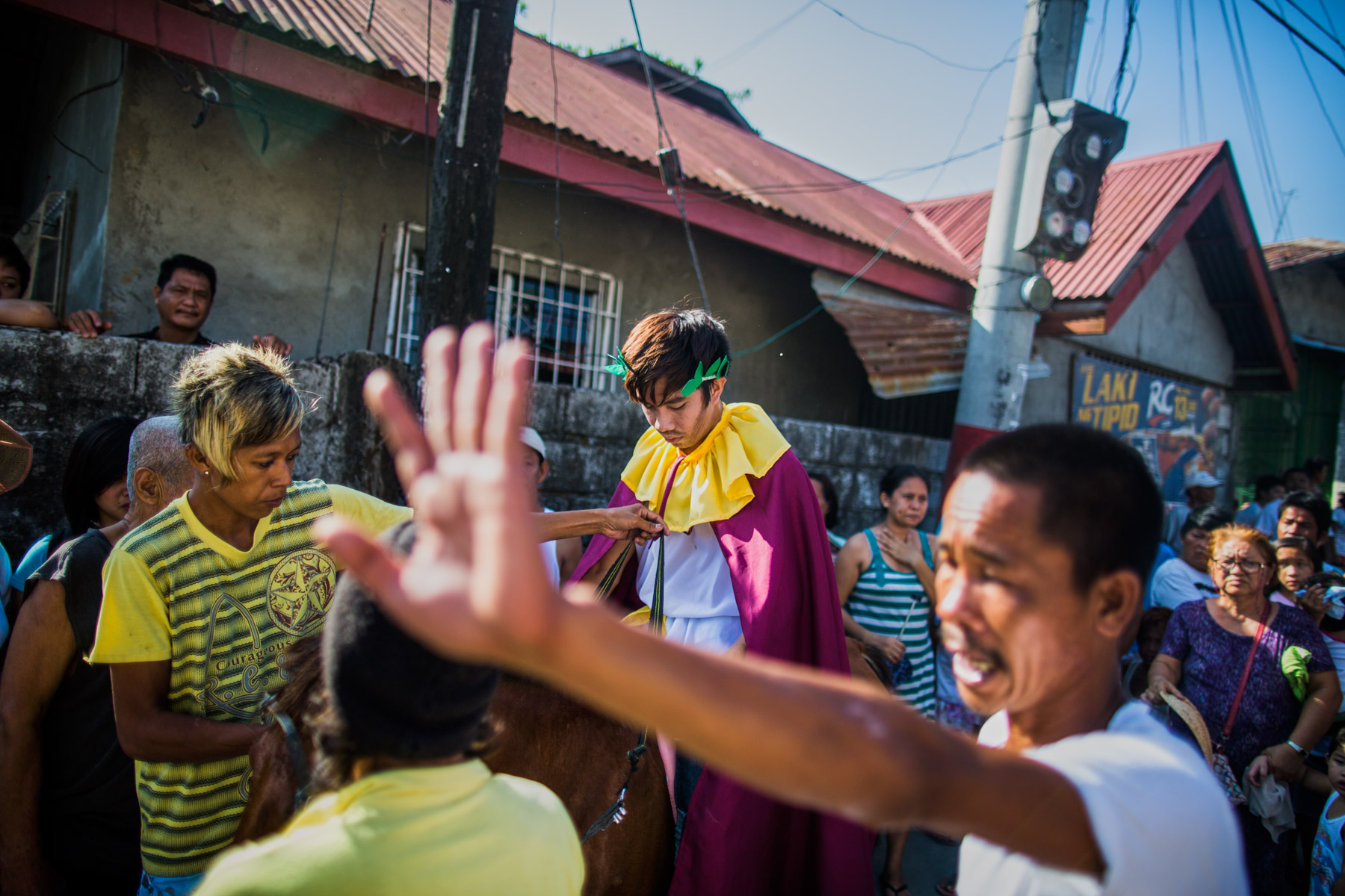 A procession of actors during the theatrical street play that is Holy Week in Pampagna, the Philippines.