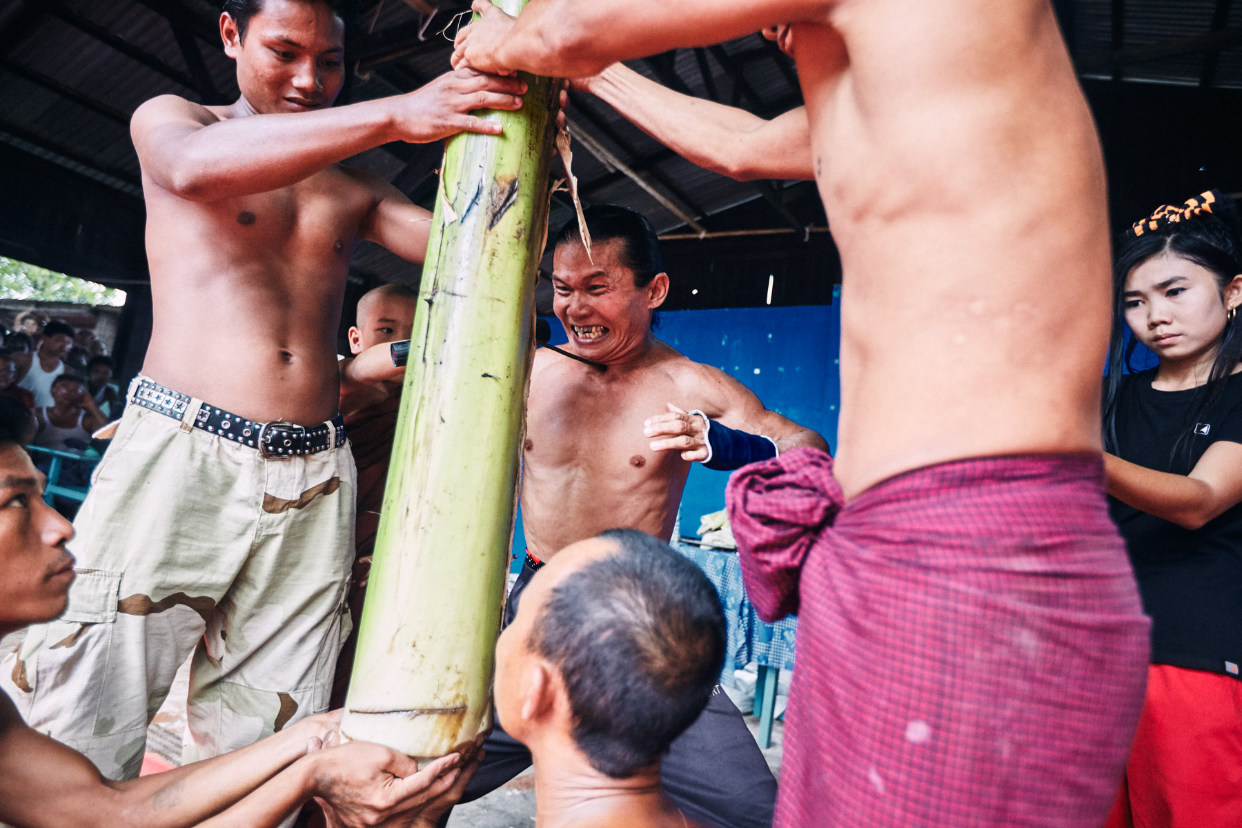 A Burmese strongman visits a monastery in Mandalay and performs feats of strength and endurance for the crowd.