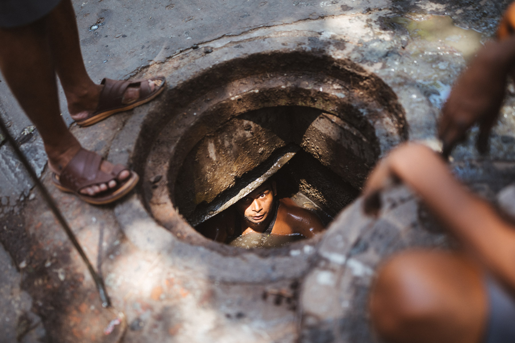 Workers clean out a city sewer in the old town of Kolkata, India.