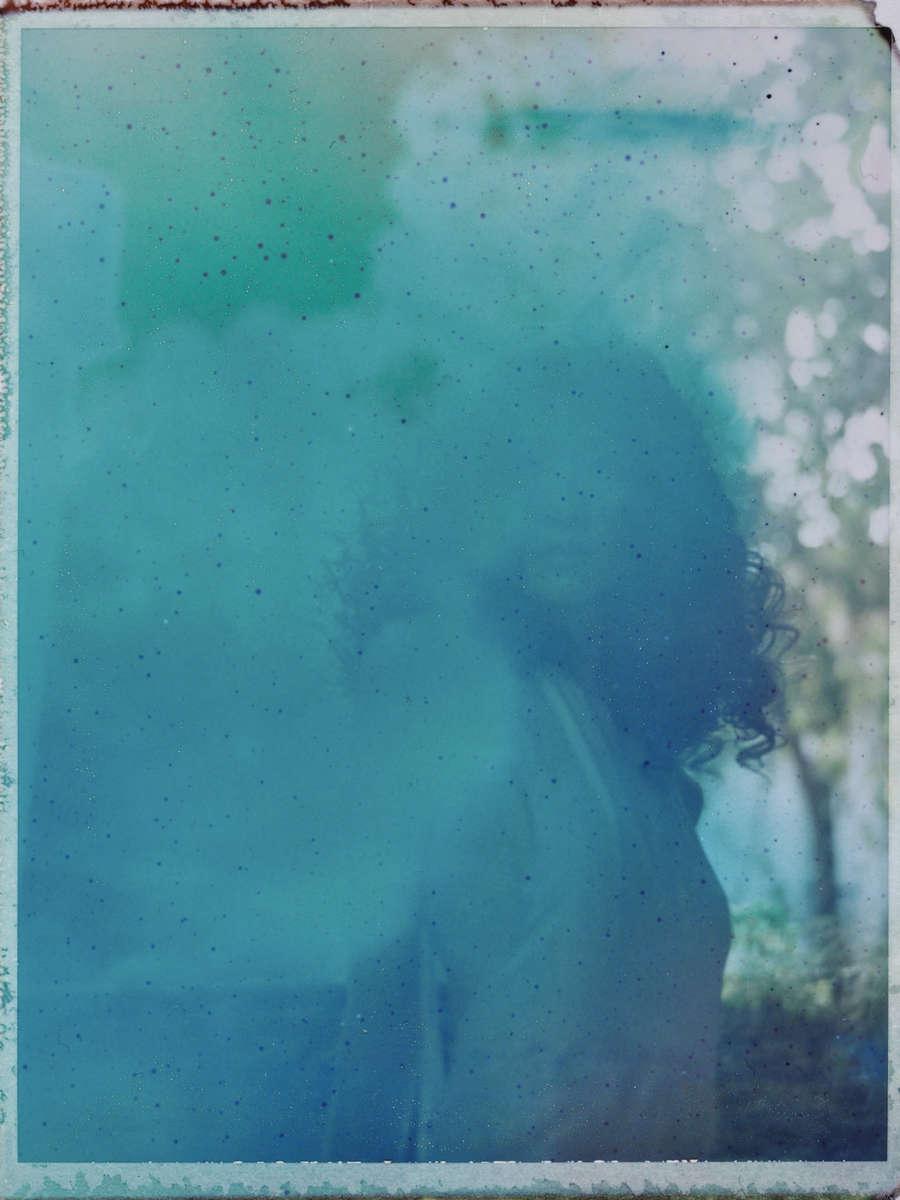 The last Polaroid burned and exposed in the harsh Hanoi sun.