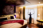 A woman throws open the blinds at the Hotel de l'Opera in Hanoi, Vietnam.