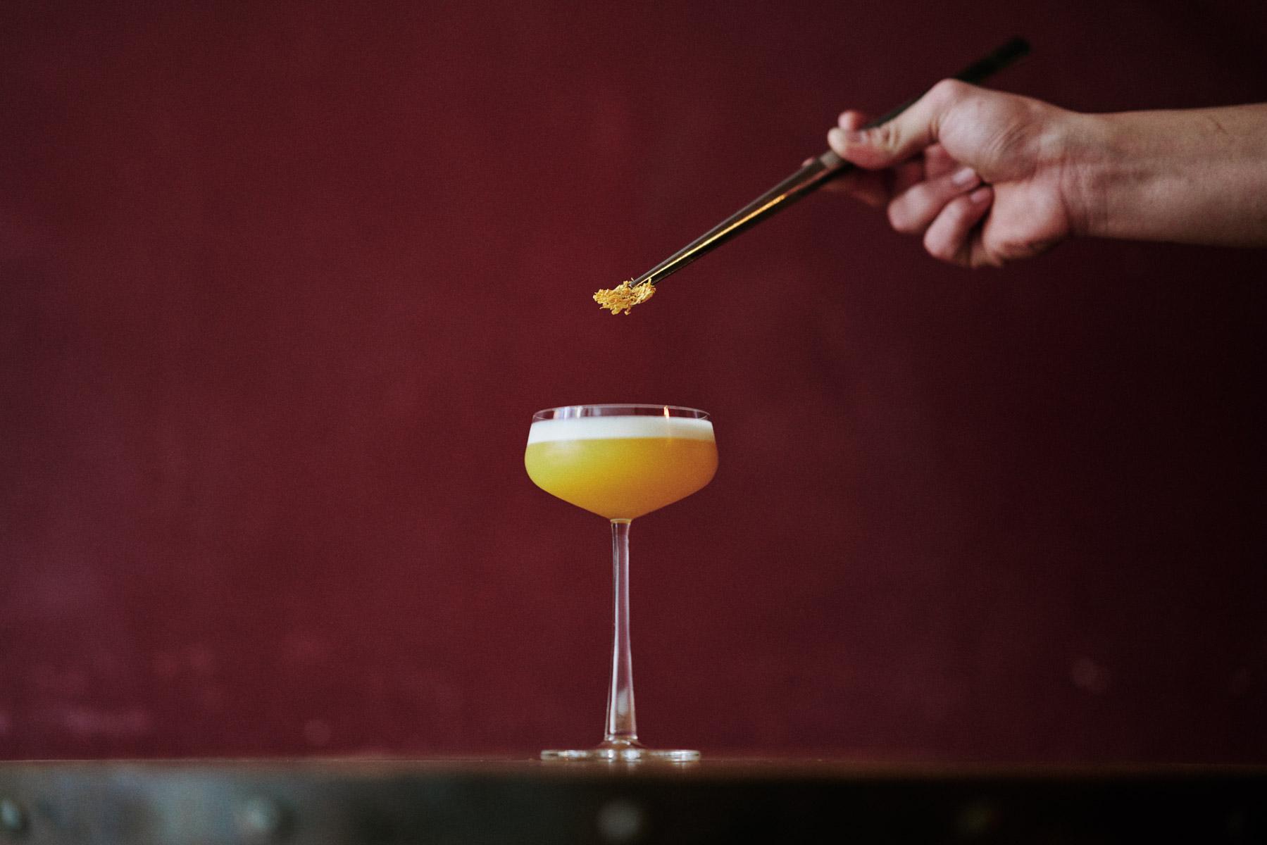 A bartender putting a final garnish on a cocktail at Ne Bar in Hanoi, Vietnam.