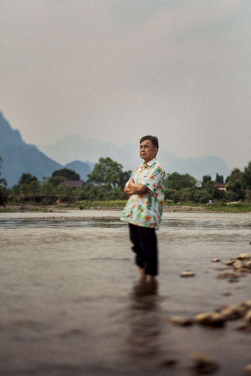 A portrait of Thanongsi Sorangkan, the owner of an organic farm and one of the accidental founders of the tubing phenomenon in Vang Vien, Laos.