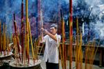 A man burns incense at Thien Hau Pagoda in Ho Chi Minh City, Vietnam.