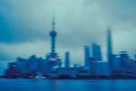 The Shanghai skyline at dusk.