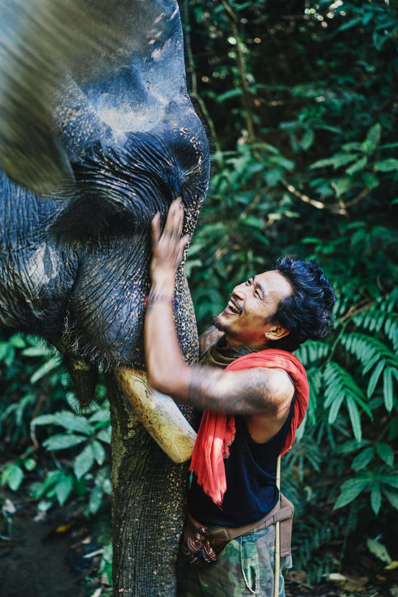 Lek and his elephant, Bonchu, in Khao Sok in southern Thailand.