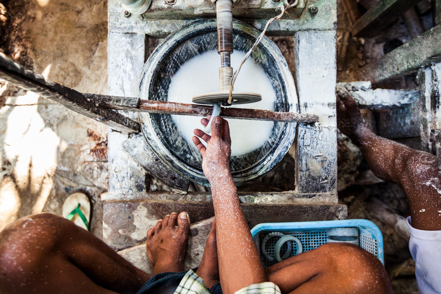 A man polishes a jade bracelet in Mandalay, Myanmar.