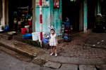 A young girl in bunny ears in the Old Quarter.