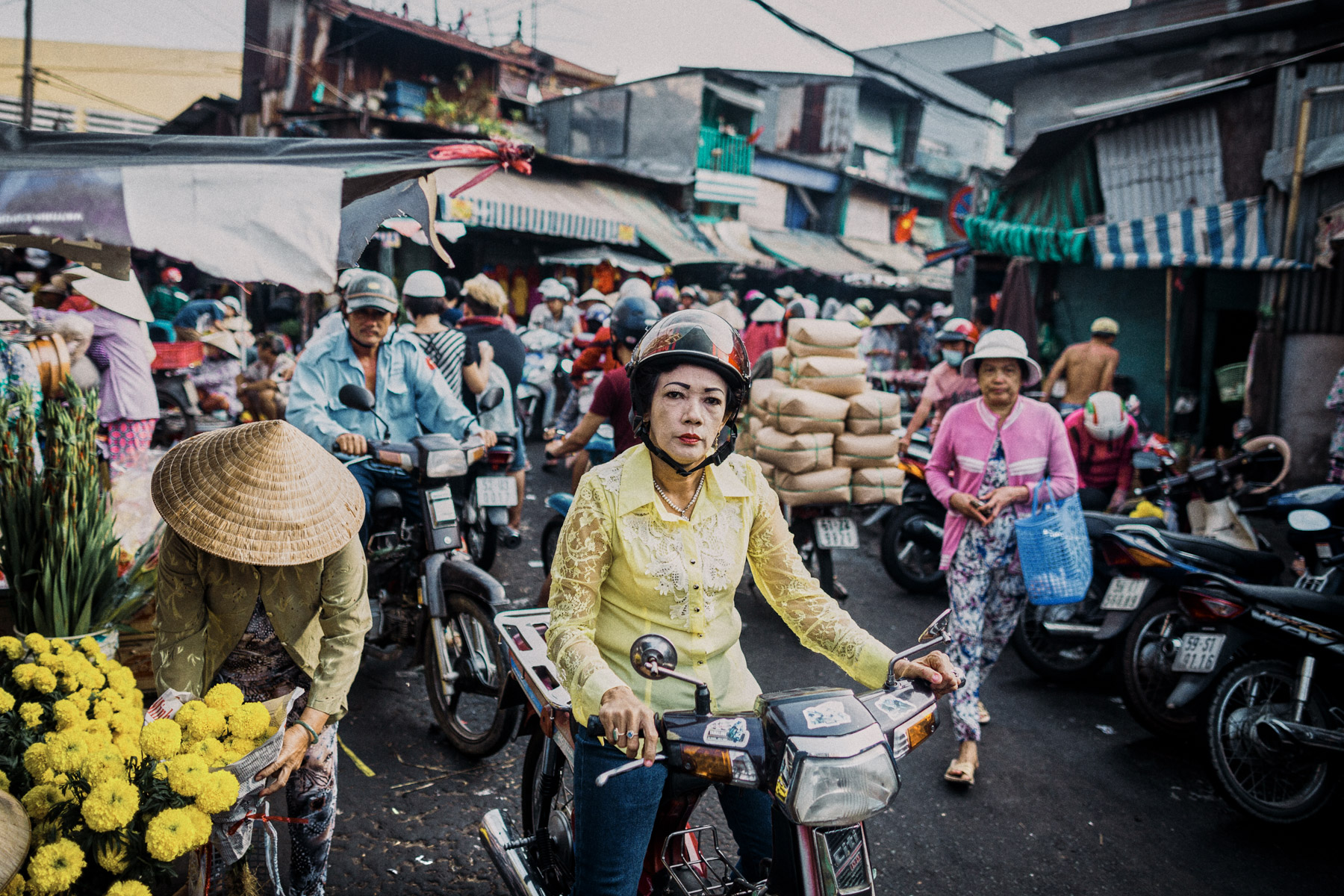 A typical market scene in District 5. Motorbikes, makeup, mayhem.