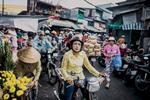 A typical market scene in District 5. Motorbikes, makeup, mayhem.
