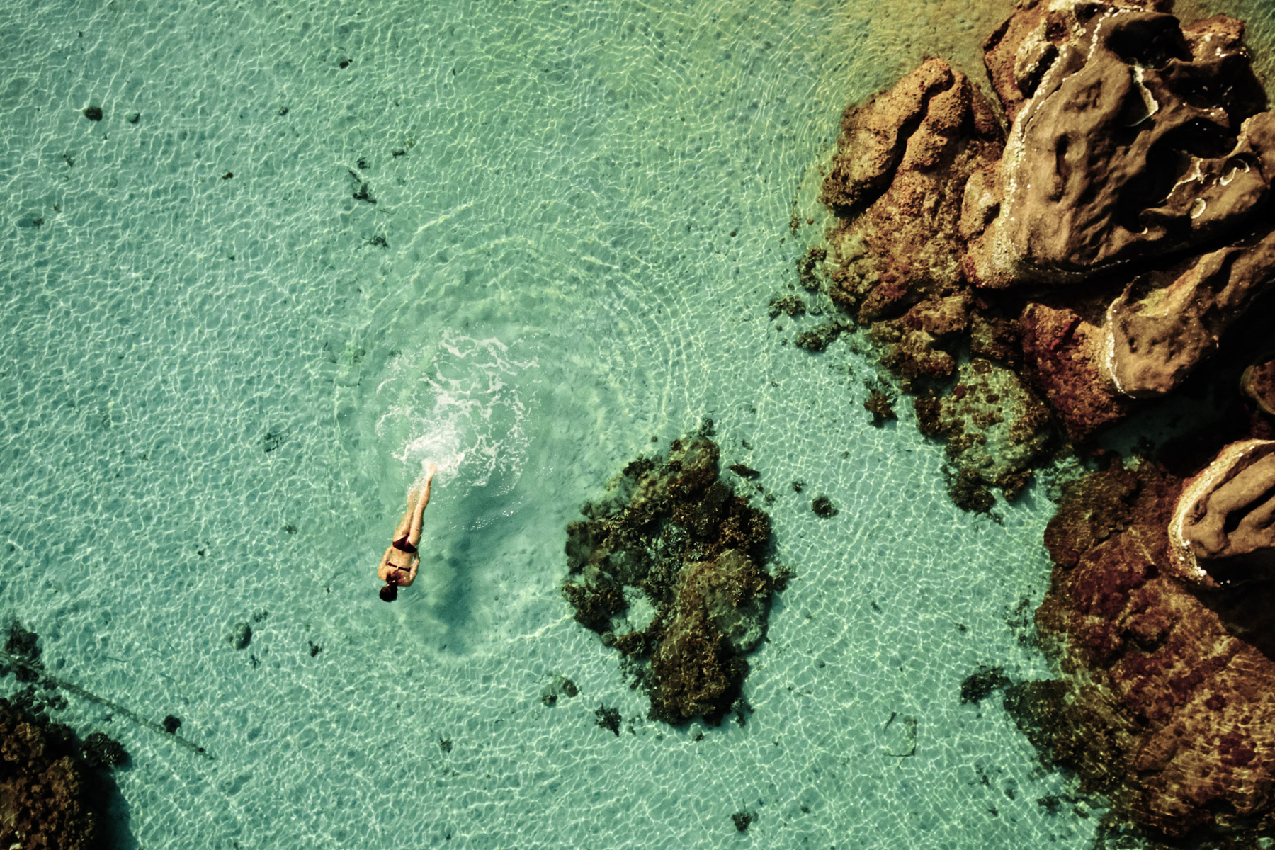 A woman swims off the coast of Phu Quoc island in southern Vietnam.