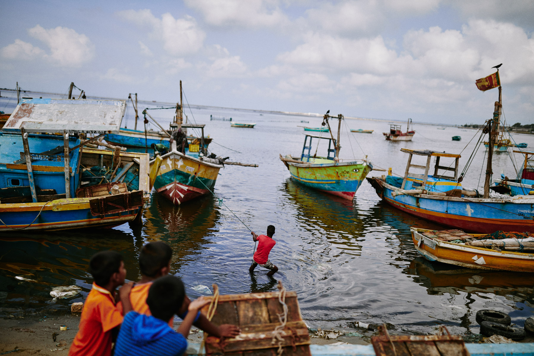 A man drags a fishing boat in from the sea on the Jaffna Peninsula in northern Sri Lanka.