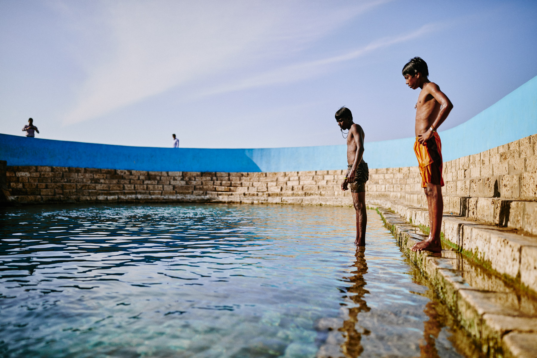 Young boys swim and dive at the Keerimalai Springs, sacred pools fed by sea waters on the northern shores of the Jaffna Peninsula in Sri Lanka.
