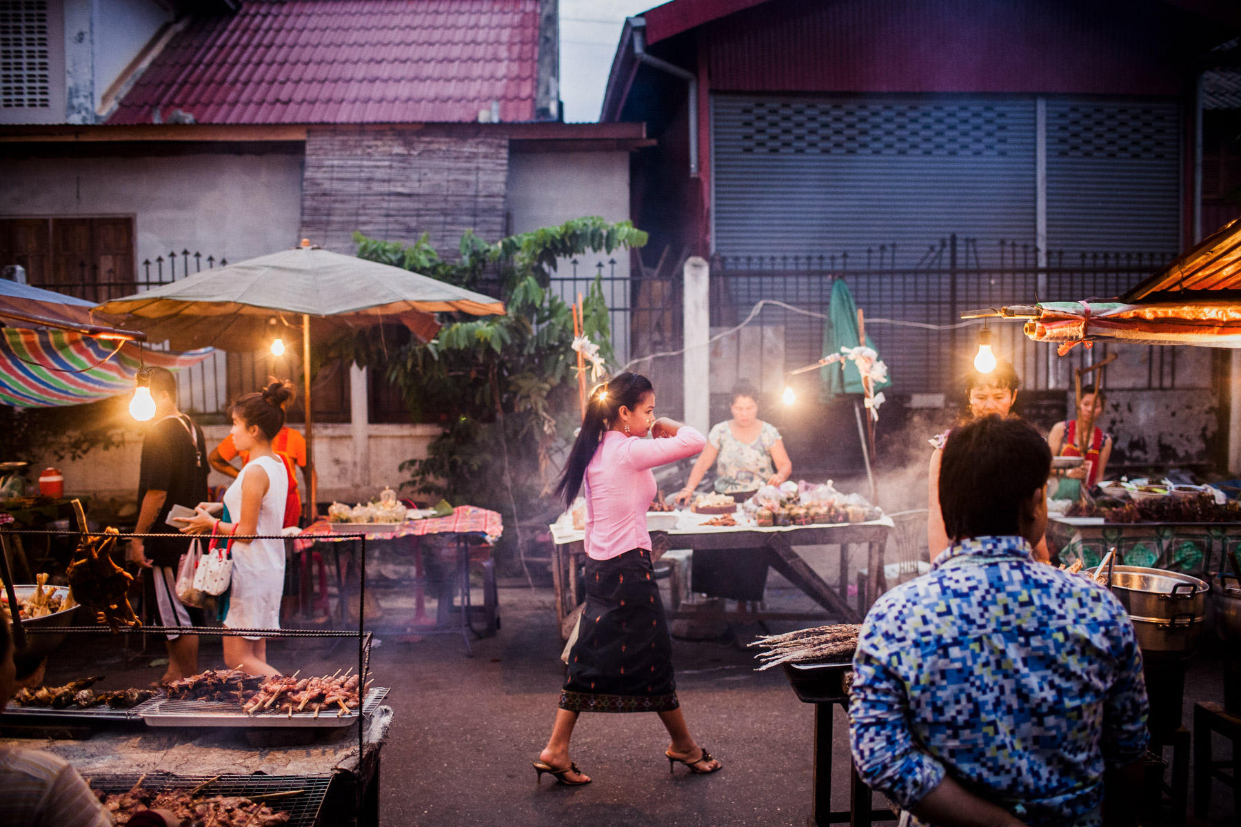 A woman walks through the Ban Anou night market in Vientiane, Laos.