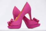 Mic Smith Photography LLC - Just Shoes 2011From hot pink pumps to flip flops, a bride's choice of footwear can say a lot about her style. Here's what some of the ladies we photographed over the past year wore as they walked down the aisle (or in some cases down the beach).  All wedding photos taken in historic Charleston, SC, Mt. Pleasant or Isle of Palms, SC, Hilton Head as well as other Lowcountry coastal communities.