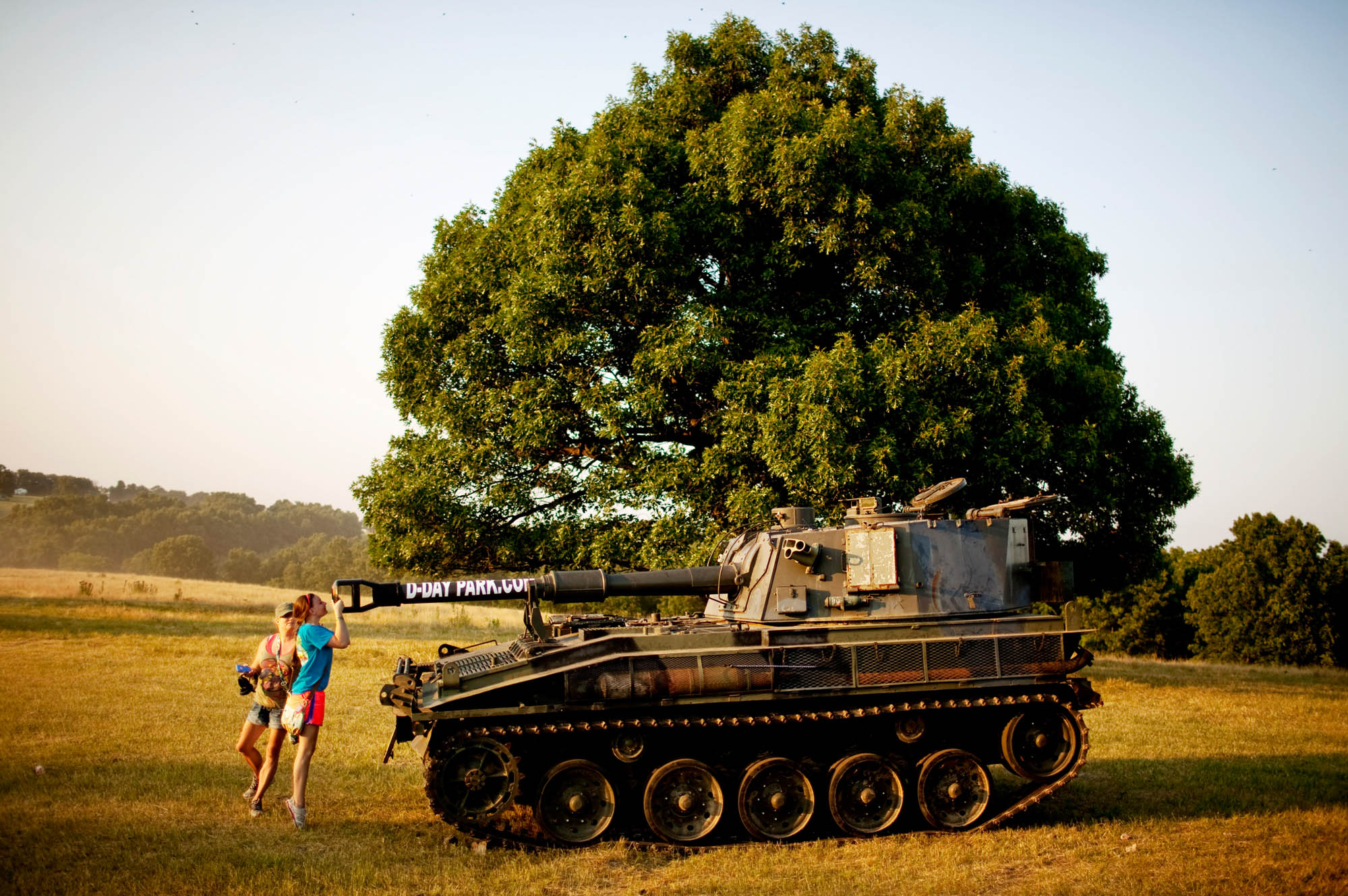 A young girl peers into the turret of a tank outside the shooting range. In addition to the tank, organizers brought an armored personnel carrier, a half-track troop carrier and a military helicopter. All were operational and available for rides to the tune of 70 dollars per person.