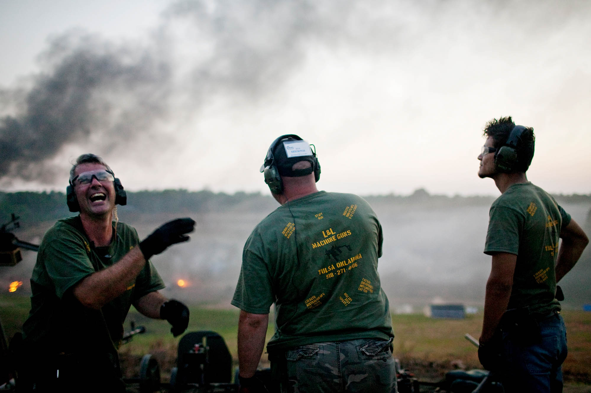 Members of the L&L Machine Gun's exhibition team joke on the firing line.