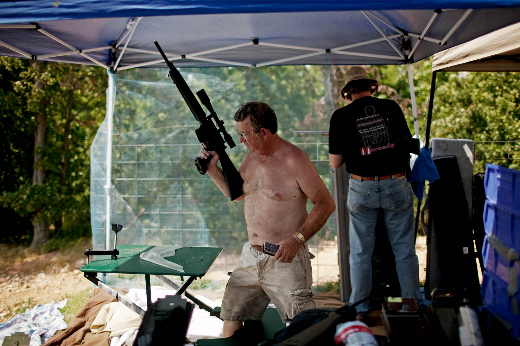 An OFASTS attendee removes his shirt due to the extreme temperature. On the weekend of the shoot, the temperature in Wyandotte reached 102.