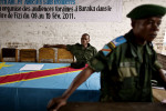 Congolese soldiers await the commencement of morning court inside a makeshift courtroom in the town of Baraka, Democratic Republic of Congo.