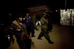 Heavily armed Congolese soldiers escort Lt. Col. Kebibi between his holding cell and the courtroom. During the trail, local and international officials were deeply concerned that fighters loyal to Kebibi would attempt to rescue him by force. As the trail proceeded, the United Nations peacekeeping force took up positions at all entry points into Baraka town in order ensure that Kebibi loyalists were not able to easily enter.