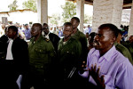 Sido Bizinungu (center), a close associate of Lt. Col. Kebibi (L), casts an intimidating gaze toward a witness as the latter testifies against the soldiers. The witness explained that Kebibi's soldiers looted his shop and brutally assaulted him during their rampage. Testifying against such hardened fighters in open court required tremendous courage on behalf of all the witnesses, none of whom had any assurance that their testimony would lead to convictions.