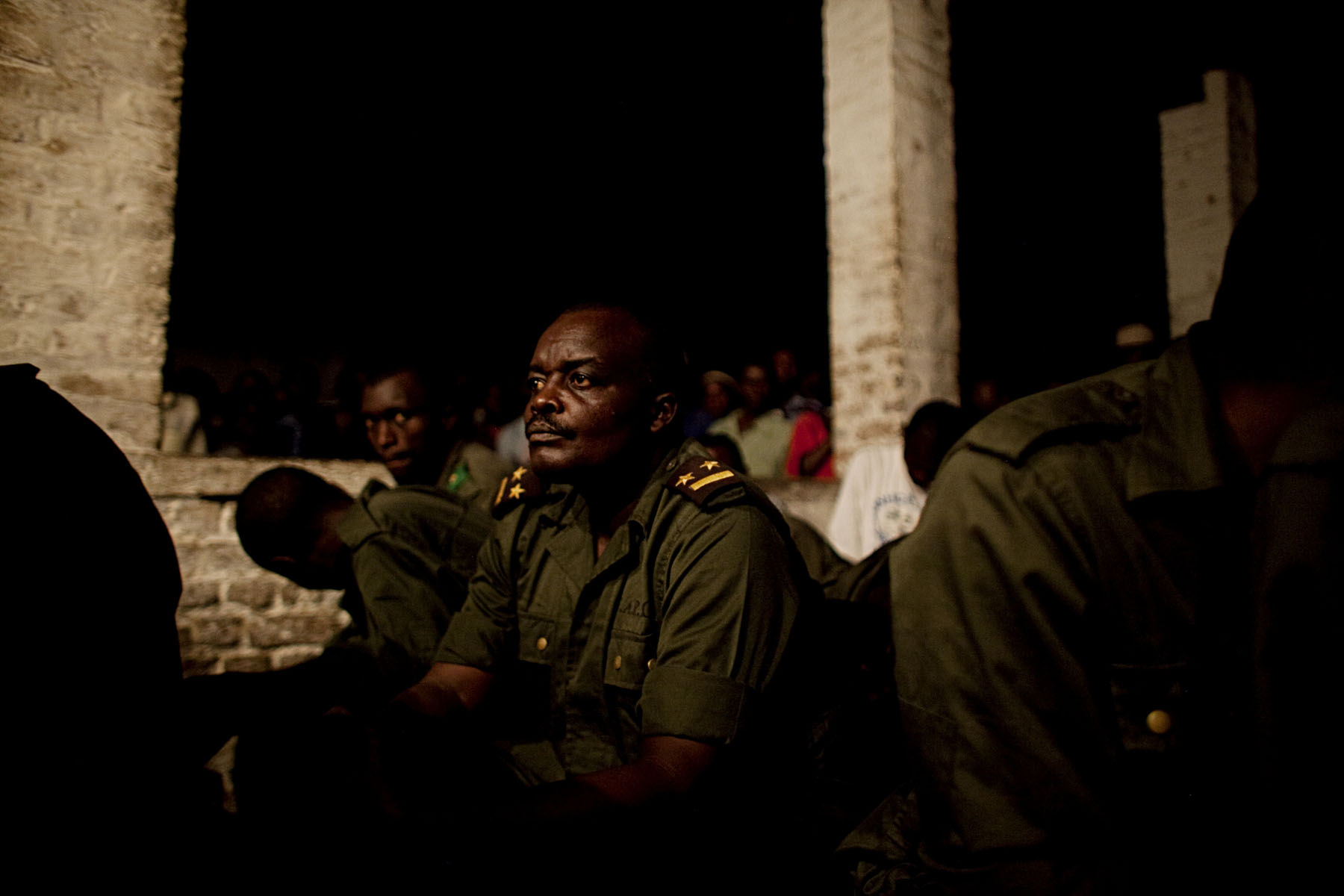 Lt. Col. Kebibi listens to arguments against him during a late night session of his trial. While this was his first trial, many indicate that Kebibi has been involved in numerous instances of rape and killing in the past.