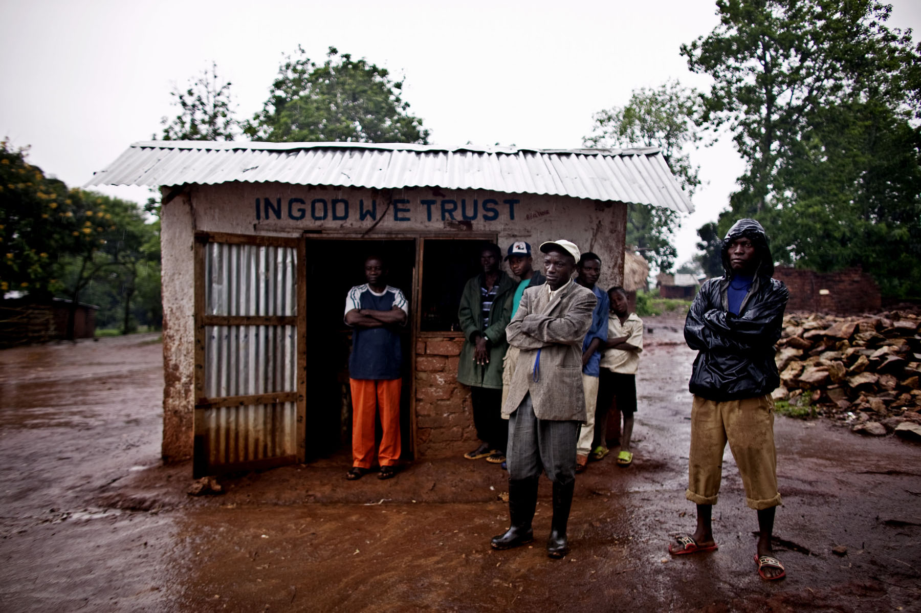 Fizi residents stand outside a shop that was looted by Lt. Col. Kebibi's marauding forces on New Year's Day. In addition to the rape of women, dozens of shops were looted and many residents were beaten.