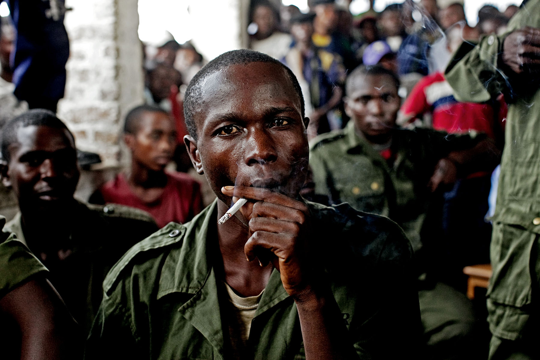 Sido Bizinungu, a close associate of Lt. Col Kebibi, smokes a cigarette during a break in sessions. Of all the soldiers, Sido struck me as the most deranged and dangerous. As other soldiers began to realize that their fate was grim, Sido remained defiantly indifferent. Early in the trial he made an attempt to smash my camera.