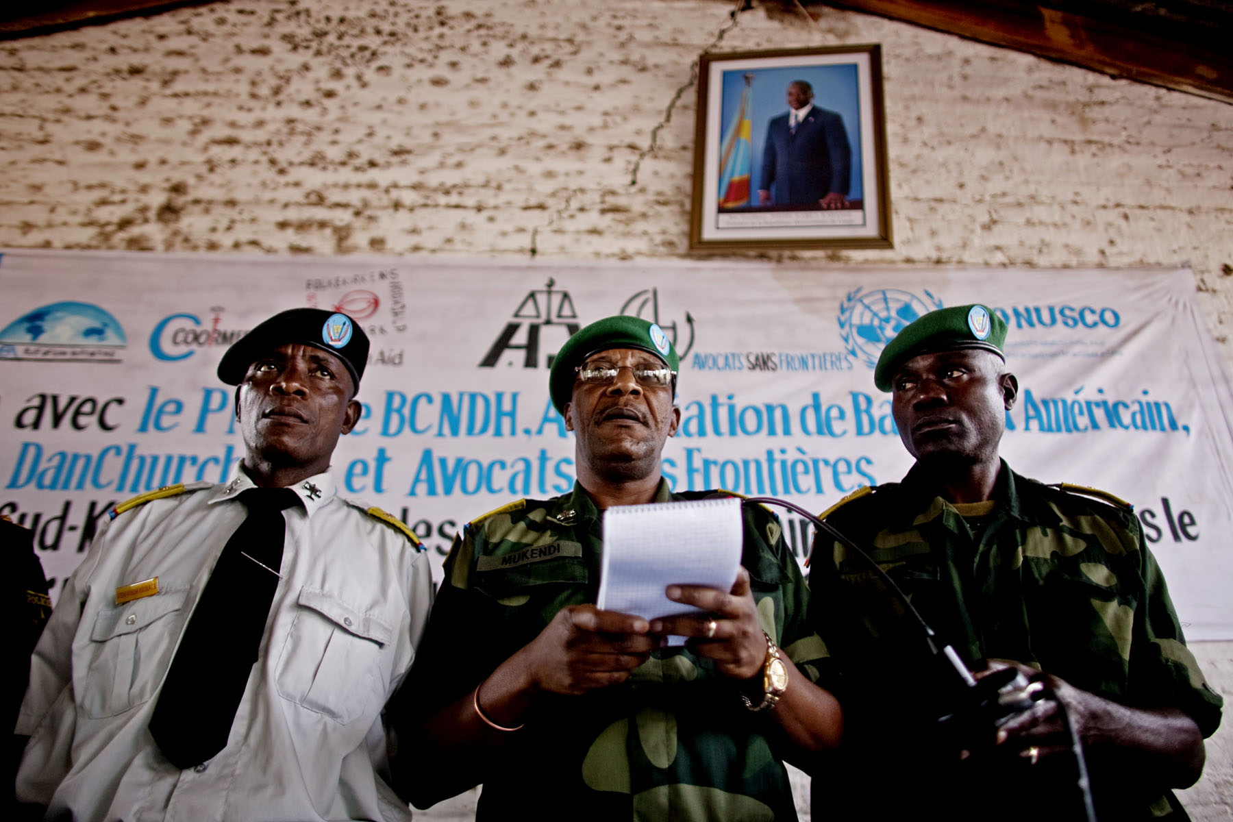 Freddy Mukendi (C), the President of the military court, reads out sentences on the final day of the trail. While the prosecution had requested the death penalty for Kebibi and others, that penalty was not handed down. The chief prosecutor was deeply disappointed and indicated that he plans to appeal those sentences. Kebibi and eight soldiers received lengthy prison sentences, one was acquitted and one was handed over to a juvenile tribunal for sentencing.