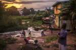 Residents of the town of Kailahun gather along a river at dusk on Tuesday, August 19, 2014. Kailahun district, in eastern Sierra Leone, has been most heavy affected by the ongoing Ebola outbreak. School in the town has been suspended and residents live in fear. (Pete Muller/Prime for the Washington Post)