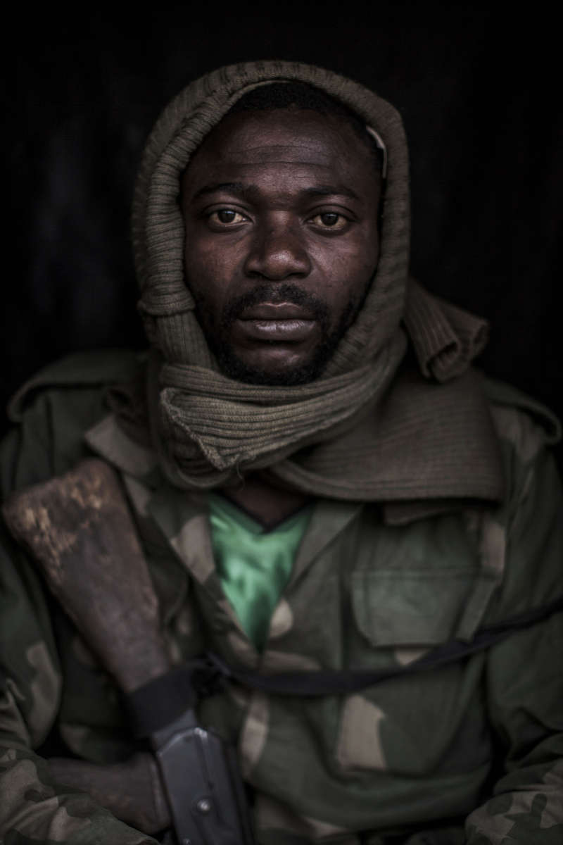 Major Sergeant Kalelo Mukambilwa Augustin, 36, of the 804th Regiment of the Congolese army sits for a portrait along a frontline at Ndumba, eastern Congo. (Pete Muller/Prime for the Washington Post)