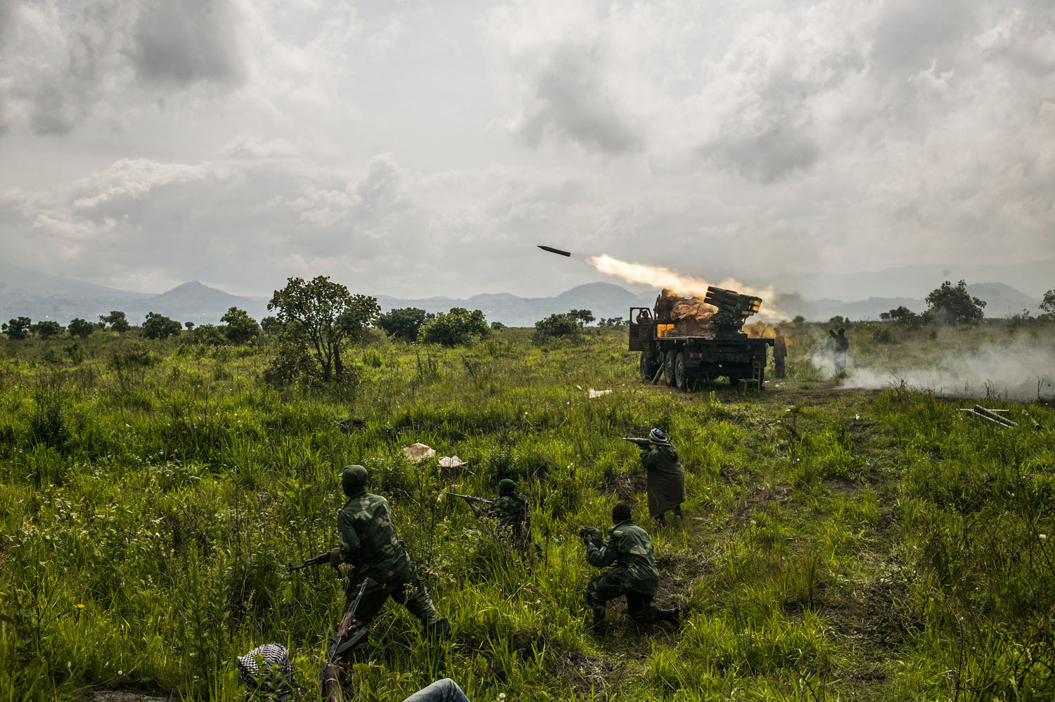 Congolese forces fire rockets toward M-23 rebel positions north of Goma.
