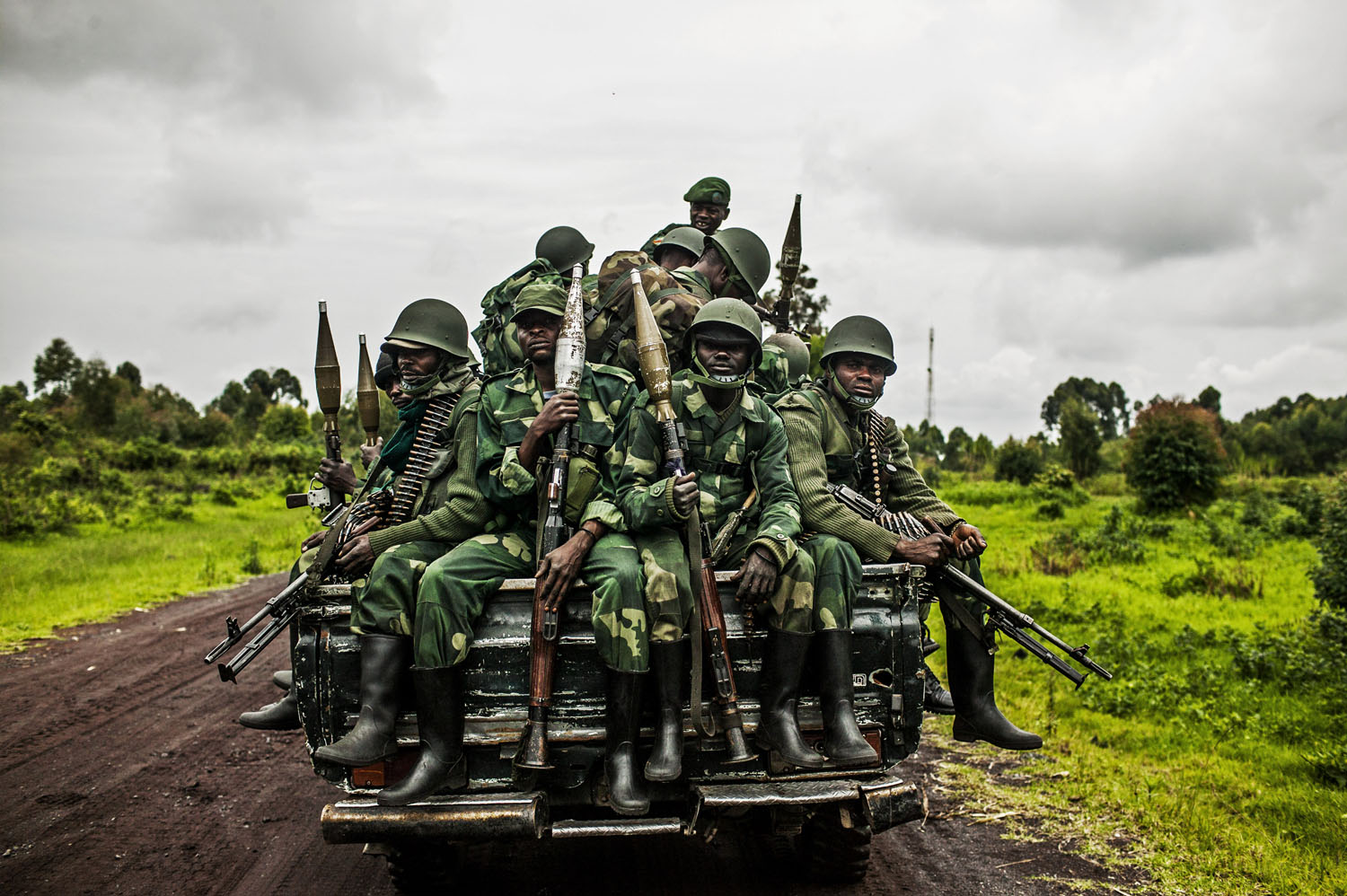 Congolese soldiers return from the frontline at Kibumba, outside Goma.