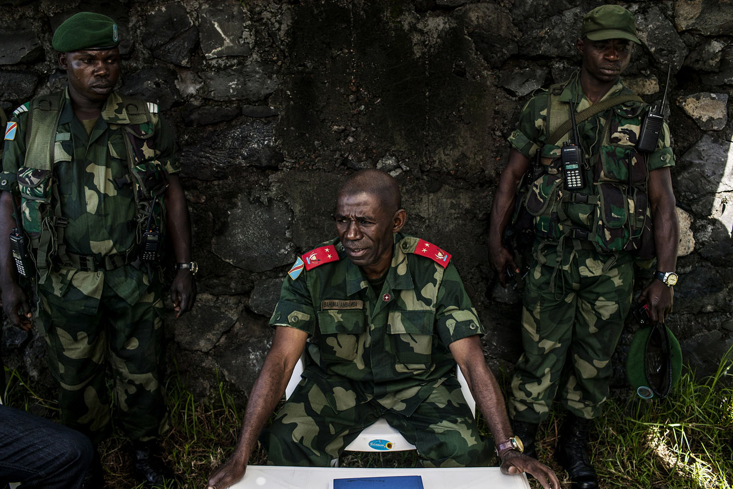 General Bahuma Ambamba, the commanding officer of all FARDC forces in eastern Congo's North Kivu Province, sits with his personal guards inside the FARDC command center in Munigi, outside Goma. General Bahuma was brought into command following the fall of Goma last year to M-23 rebels. Beyond suppressing the M-23 rebellion, which is the largest and most threatening rebellion in eastern Congo at the moment, Bahuma also has ambitions of reforming the way in which the FARDC functions.