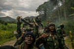 Congolese soldiers celebrate as they advance up the mountainous road toward Bunagana, the last remaining stronghold of the M-23 rebels.
