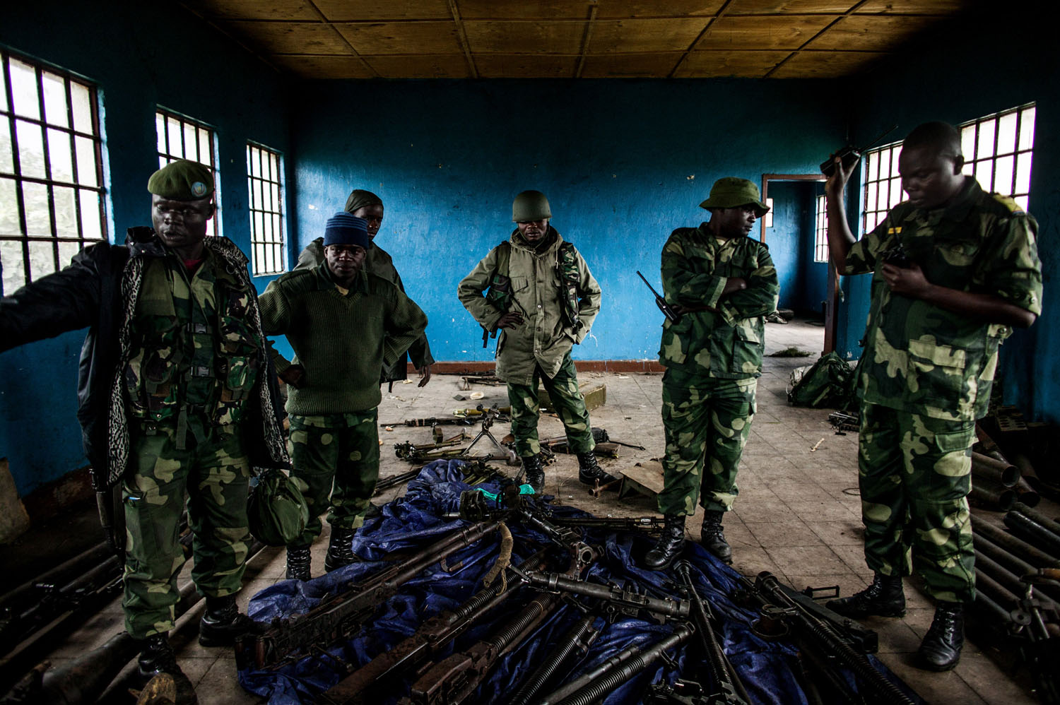 Congolese soldiers inspect munitions abandoned by M23 rebels at a former M-23 military base in Rumangabo, north of Goma.