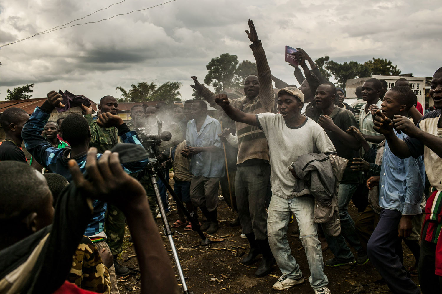With heavy guns still smoking, residents of the town of Bunagana, celebrate the routing of M-23 rebels by the Congolese army.