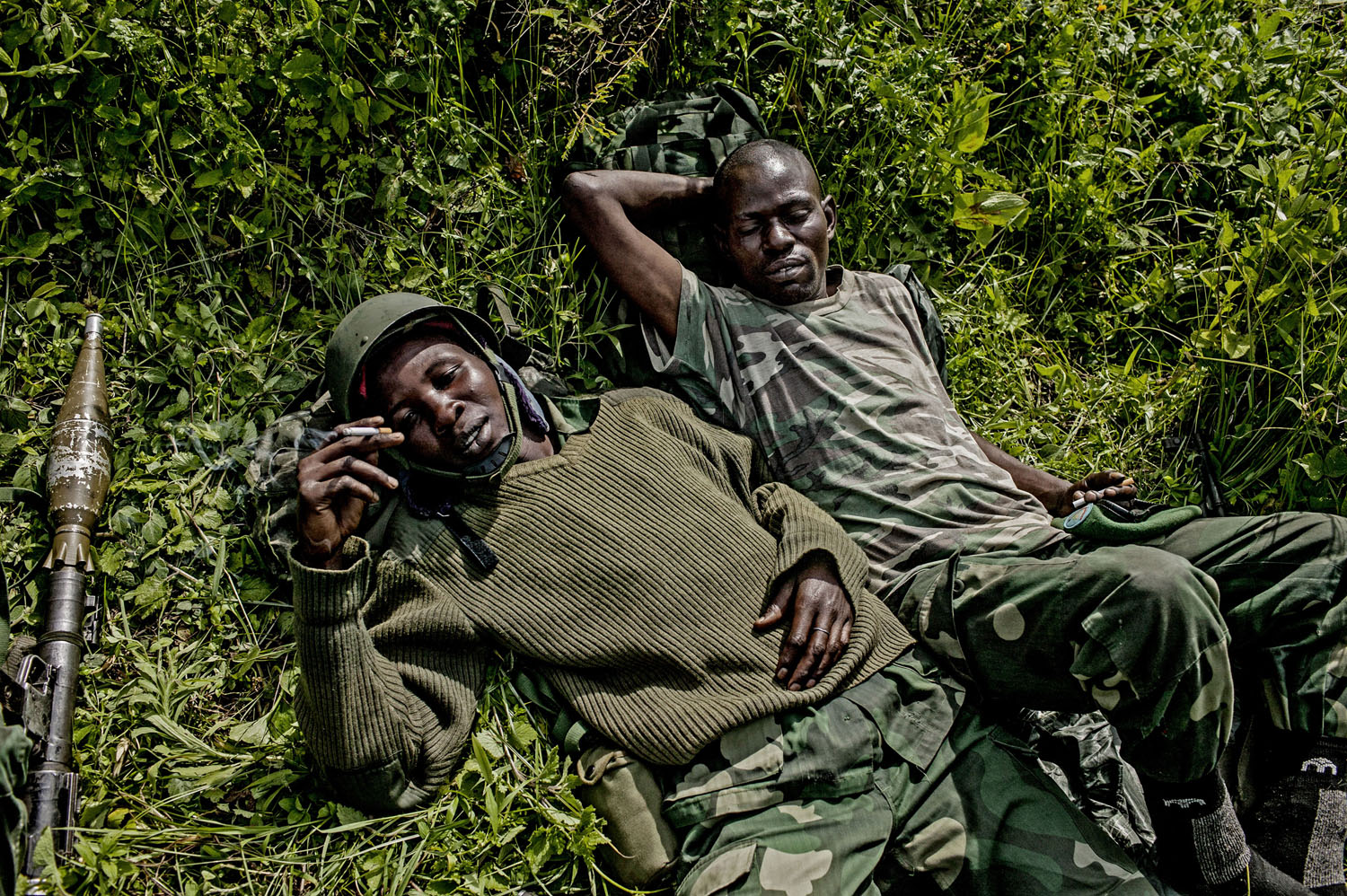 Congolese soldiers rest behind the frontline with M-23 rebels behind the frontline north of Goma