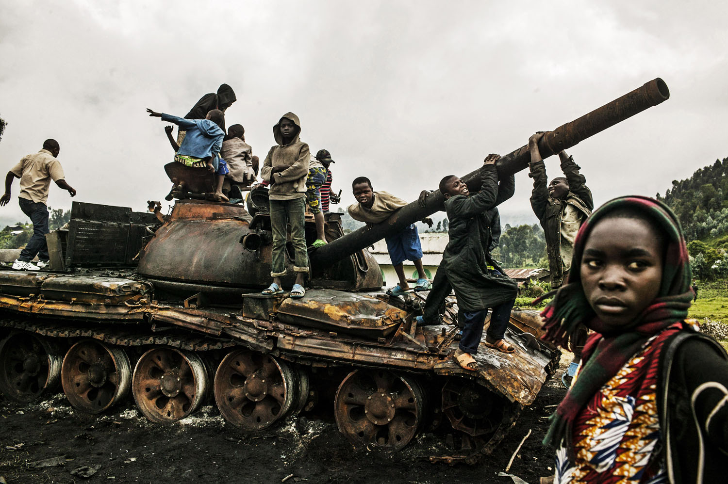 Congolese children play on a destroyed M-23 tank near Kibumba, north of Goma on Tuesday. Kibumba was the site of heavy fighting between the Congolese army and M-23 rebels.