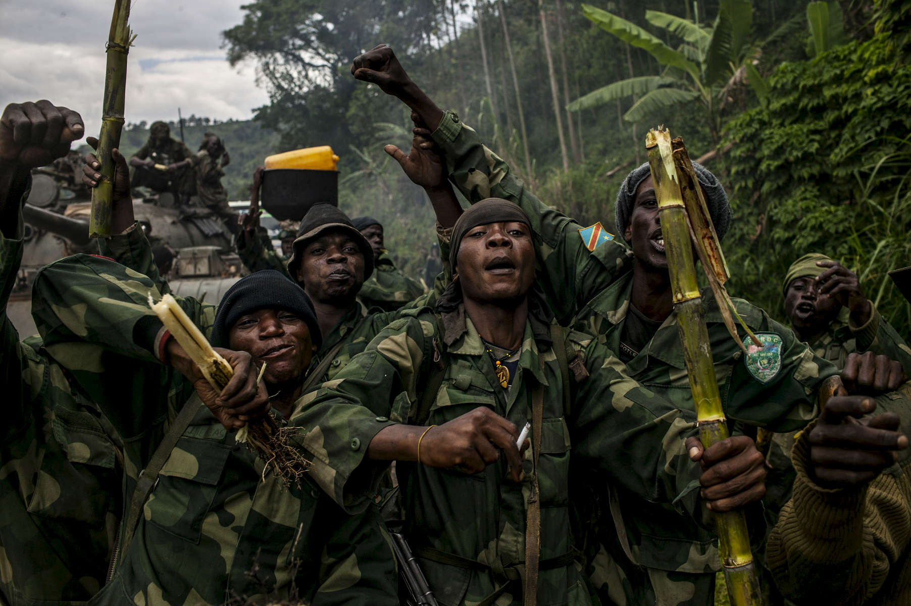 Congolese commandos celebrate as they advance up the mountainous road toward Bunagana, the last remaining stronghold of the M-23 rebels on Wednesday.(Pete Muller for the New York Times)