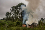 A house burns at the frontline near the village of Ndumba, in eastern Congo, Sunday, April 13, 2014. Sporadic fighting and ambushes between the Congolese army and the Mai Mai APCLS occurred throughout the day. (Pete Muller/Prime for the Washington Post)