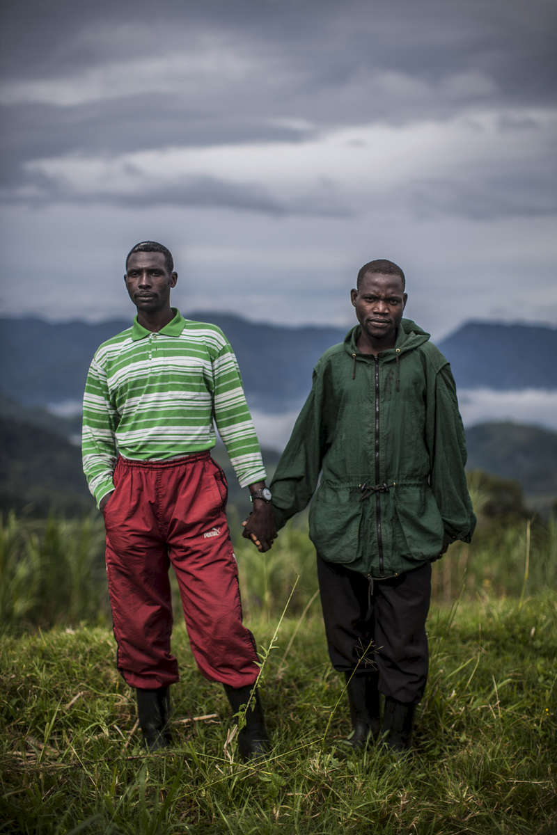 Two members of the FDLR stand for a portrait on a hilltop base near the village of Ihula, eastern Congo, on Saturday, April 12, 2014. (Pete Muller/Prime for the Washington Post)