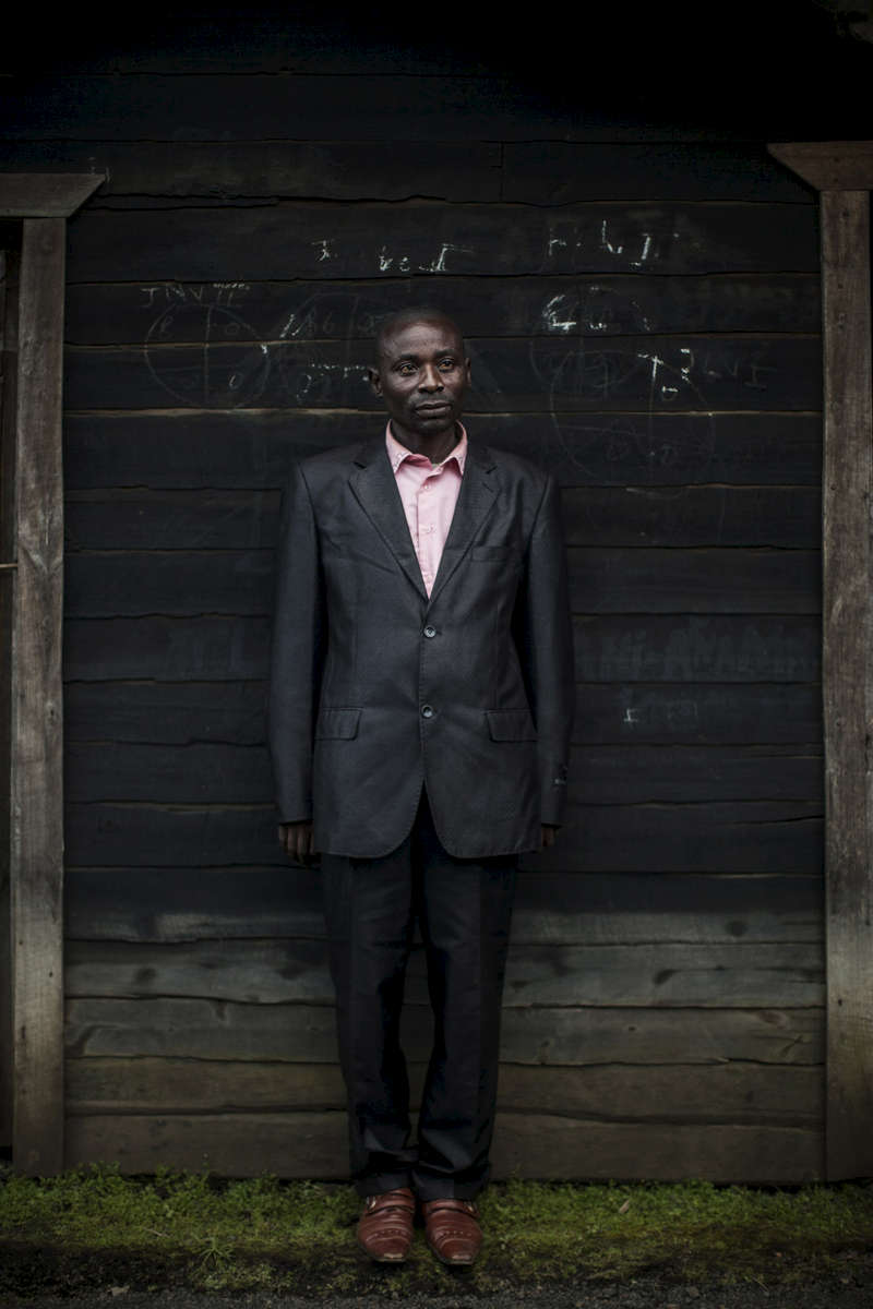 A Congolese civilian pastor stands for a portrait in a village in North Kivu province. (Pete Muller)