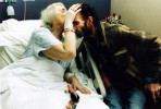 Hospitalized with terminal cancer Peter's mother kisses him a final goodbye.