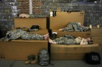 Soldiers catch some sleep around 1:45 am before the 3am wakeup at the Freehold National Guard armory in Freehold. New Jersey National Guard Bravo Company 1-114th.