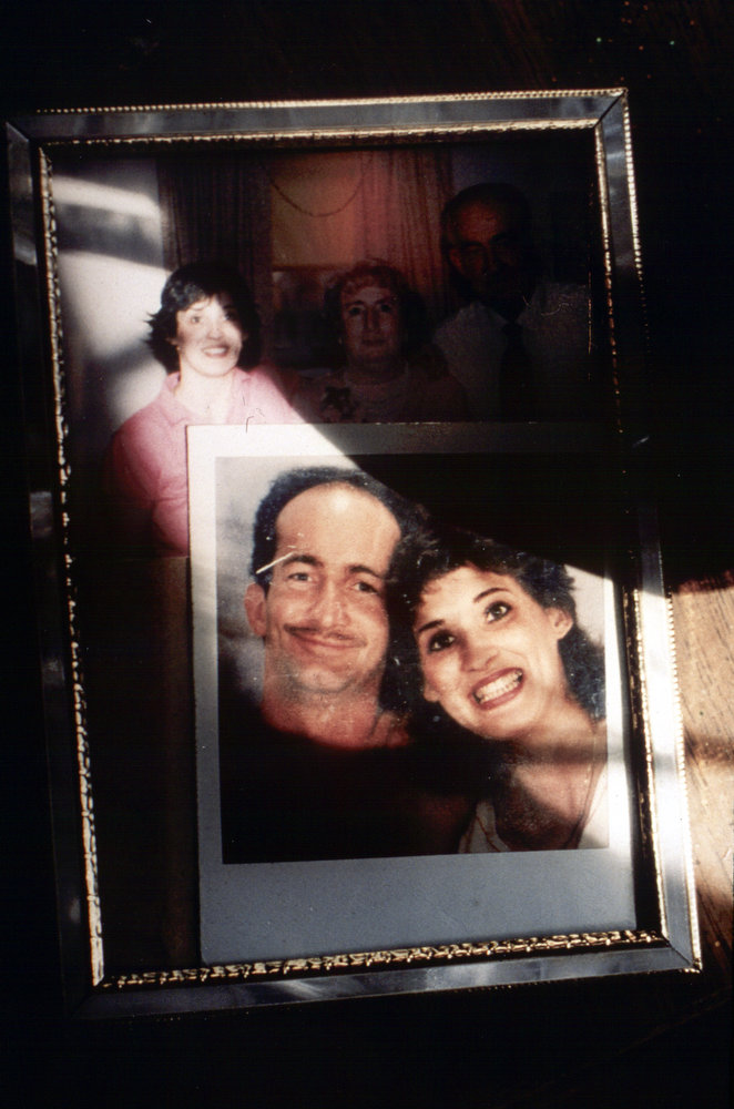 A picture of a healthy Peter McDonough with his girlfriend of three years sits in front of an earlier picture of them with his parents.