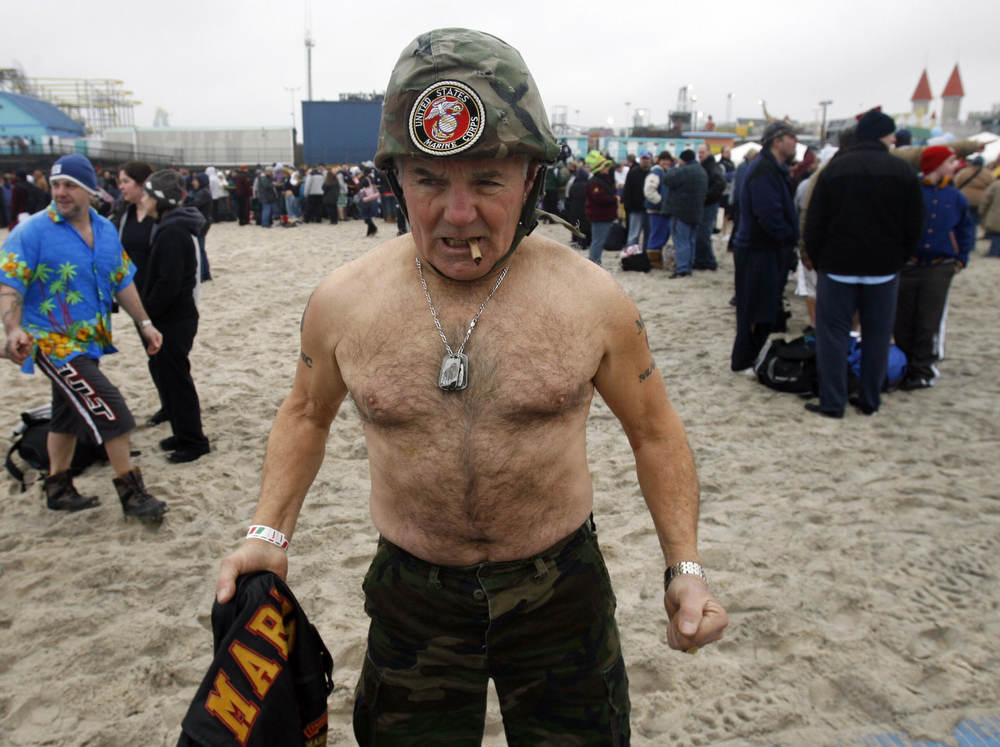 Mel Mescarsos, a marine, psyches himself up for the The Polar Bear plunge fundraiser for special olympics at Seaside Heights.