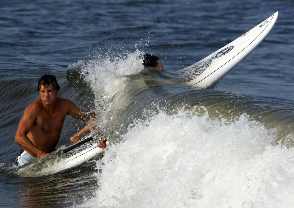 Andrew Mencinsky of Sea Bright and his son Gavin Mencinsky 5 do some surfing at Sandy Hook Park.