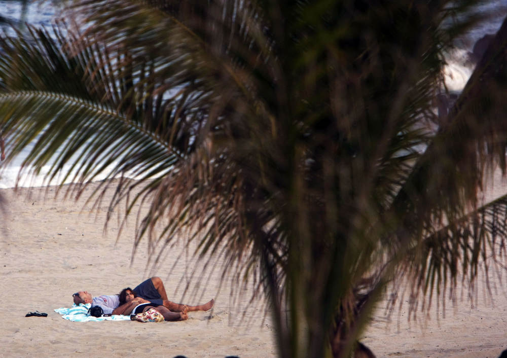 Sleeping under the palms on the New Jersey beach in Long Branch.
